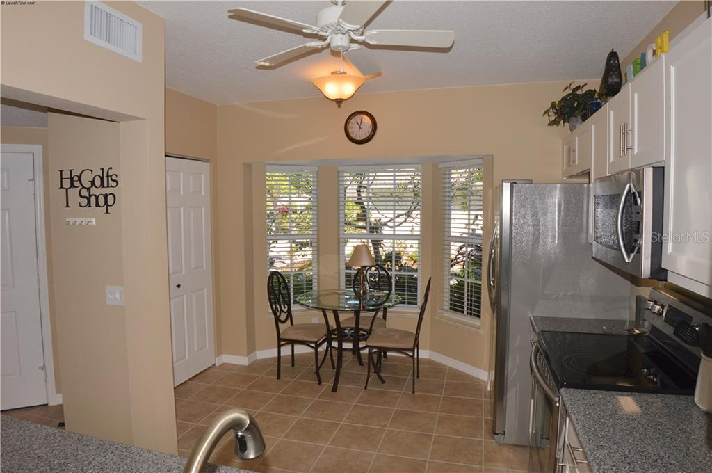 Kitchen to dinette - Condo for sale at 903 Addington Ct #102, Venice, FL 34293 - MLS Number is N5916962