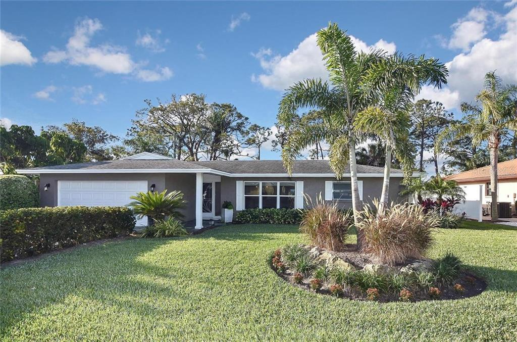 Front with new landscaping. - Single Family Home for sale at 405 Sunset Dr, Venice, FL 34285 - MLS Number is N5917234