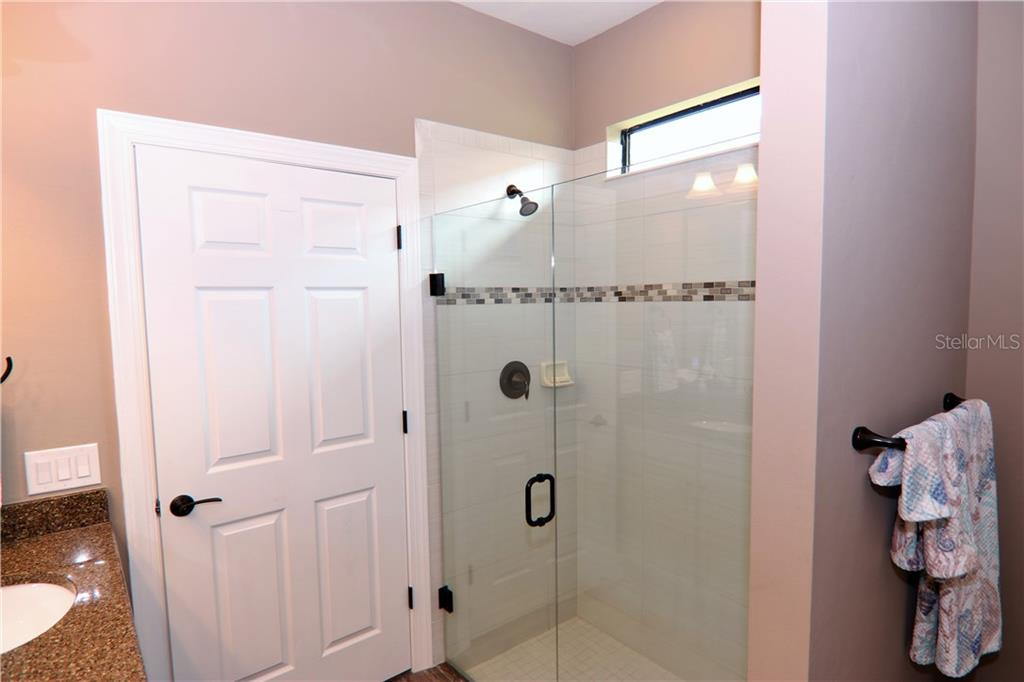 Master bath shower with heavy glass frame-less door - Single Family Home for sale at 13880 Lido St, Venice, FL 34293 - MLS Number is N5917319
