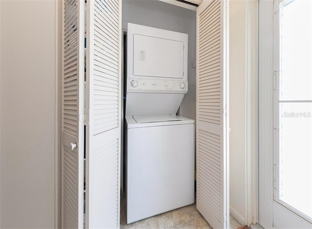 In-unit stack-able washer and dryer is a luxury! - Condo for sale at 100 The Esplanade N #4, Venice, FL 34285 - MLS Number is N6100334