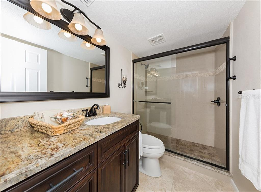 Updated En-suite bath with large vanity, retiled walk in shower, new toilet, flooring and all hardware. - Condo for sale at 500 Park Blvd S #67, Venice, FL 34285 - MLS Number is N6100360