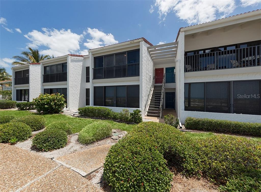 Contemporary design, well manicured grounds, and a bright red door welcome you. - Condo for sale at 500 Park Blvd S #67, Venice, FL 34285 - MLS Number is N6100360