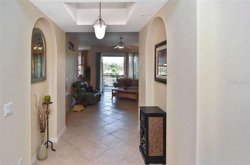 Foyer to living room - Condo for sale at 940 Cooper St #202, Venice, FL 34285 - MLS Number is N6101184