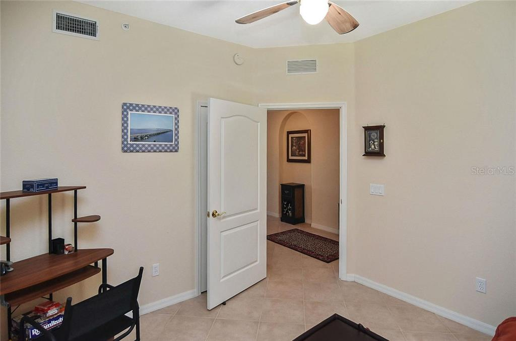 Bedroom 3 to foyer - Condo for sale at 940 Cooper St #202, Venice, FL 34285 - MLS Number is N6101184