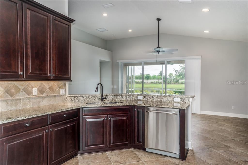 Granite Counters and Tile Backsplash - Single Family Home for sale at 2290 Terracina Dr, Venice, FL 34292 - MLS Number is N6101301