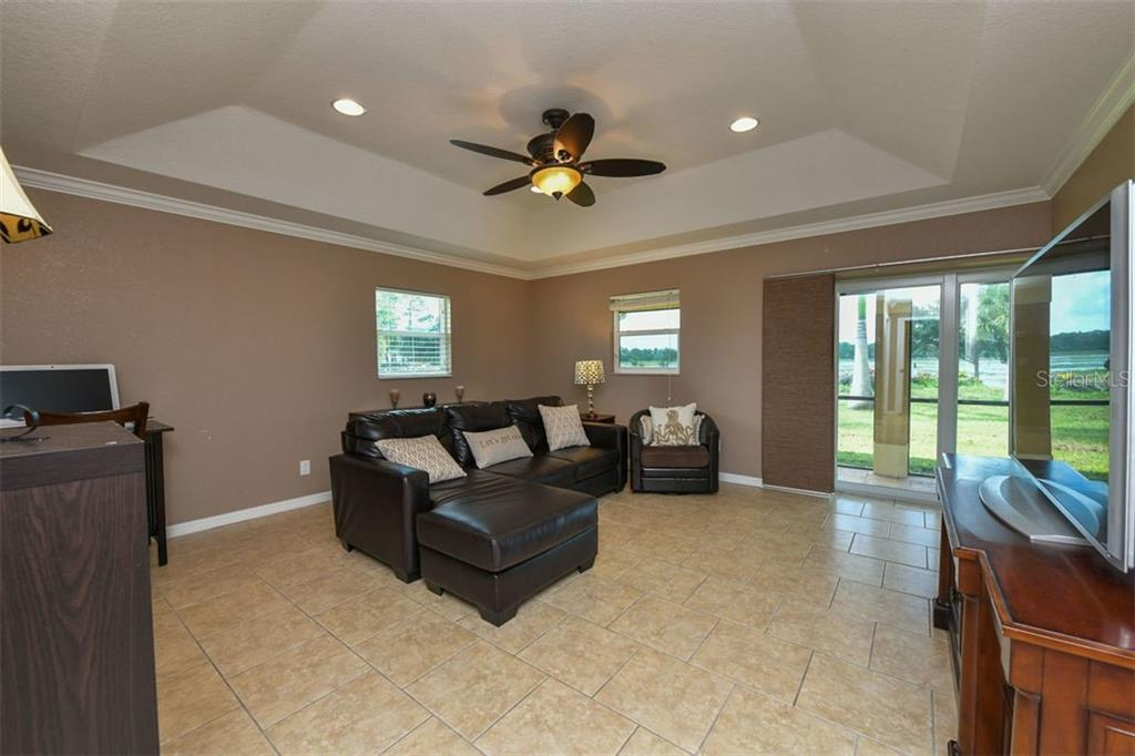 Guest house living room - Single Family Home for sale at 9150 Deer Ct, Venice, FL 34293 - MLS Number is N6101408