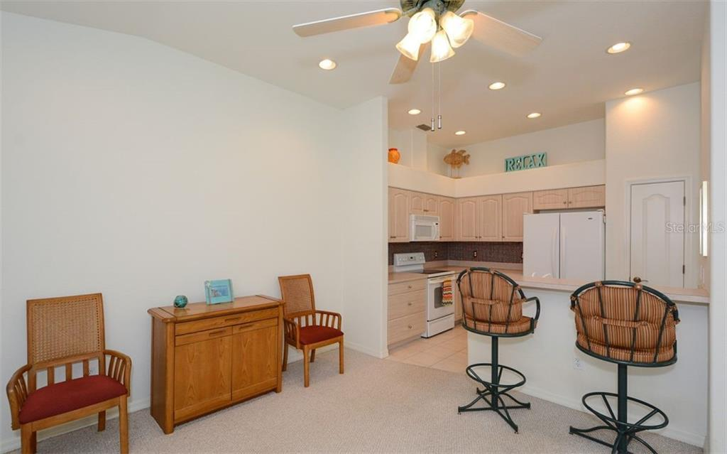 Breakfast bar to kitchen - Villa for sale at 313 Auburn Woods Cir, Venice, FL 34292 - MLS Number is N6101432