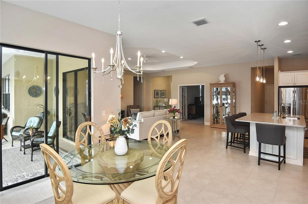 Dining room to kitchen and great room - Single Family Home for sale at 21220 St Petersburg Dr, Venice, FL 34293 - MLS Number is N6101838