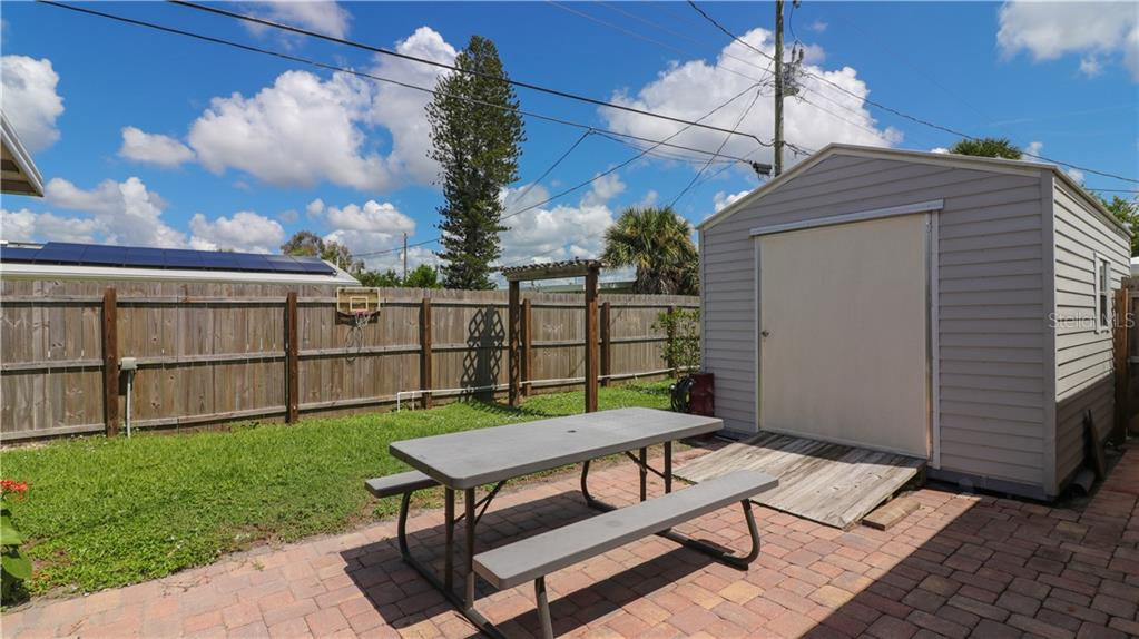 Back patio with pavers for bbq time! Venice Gardens Venice FL - Single Family Home for sale at 401 Shamrock Blvd, Venice, FL 34293 - MLS Number is N6102109