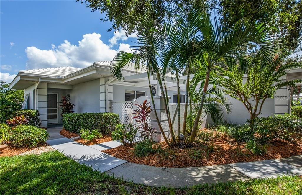 Beautiful tropical landscaping abounds! - Villa for sale at 206 Cerromar Way S #25, Venice, FL 34293 - MLS Number is N6102127