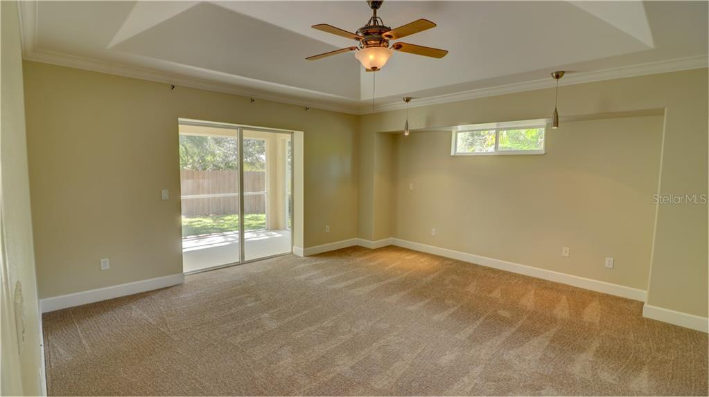Master bedroom with pocket sliders to the lanai - Single Family Home for sale at 409 Palm Ave, Nokomis, FL 34275 - MLS Number is N6102313