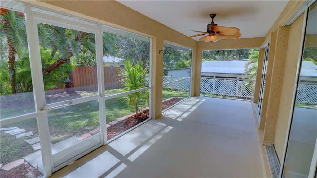 Large screened lanai - Single Family Home for sale at 409 Palm Ave, Nokomis, FL 34275 - MLS Number is N6102313