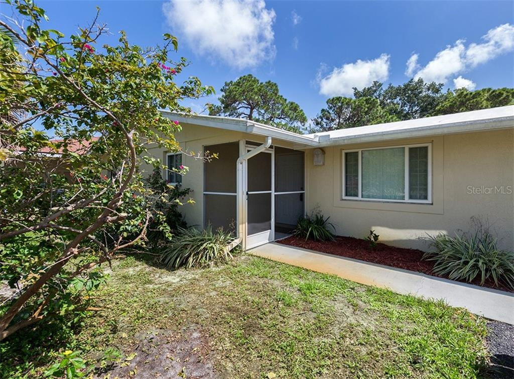 Entry - Single Family Home for sale at 717 Guild Dr, Venice, FL 34285 - MLS Number is N6103134