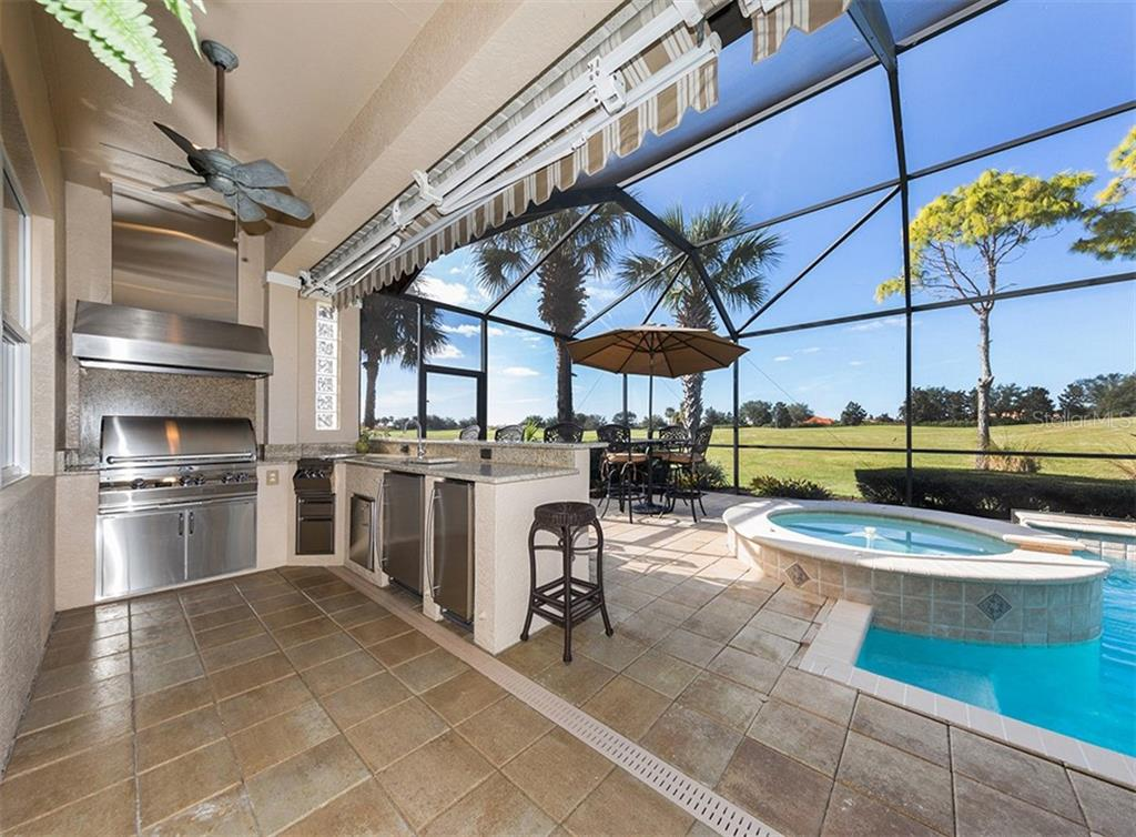 Outdoor kitchen - Single Family Home for sale at 110 Martellago Dr, North Venice, FL 34275 - MLS Number is N6103159