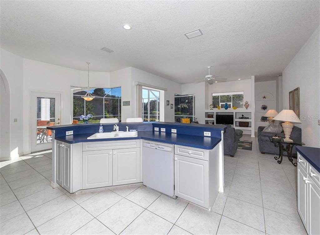 Kitchen to dinette and family room - Single Family Home for sale at 2201 Sonoma Dr E, Nokomis, FL 34275 - MLS Number is N6103410