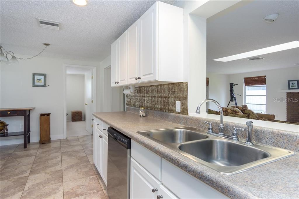 pass through to family room, updated kitchen, stainless appliances, and beautiful back splash. - Single Family Home for sale at 3656 Clematis Rd, Venice, FL 34293 - MLS Number is N6103558