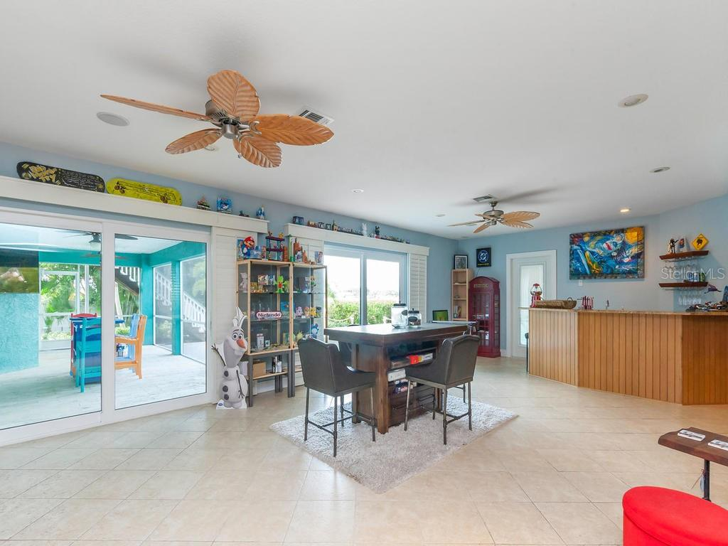 1st level bonus room - Single Family Home for sale at 735 Eagle Point Dr, Venice, FL 34285 - MLS Number is N6103576