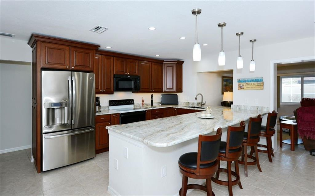 Kitchen - Single Family Home for sale at 1460 Strada D Argento, Venice, FL 34292 - MLS Number is N6104612