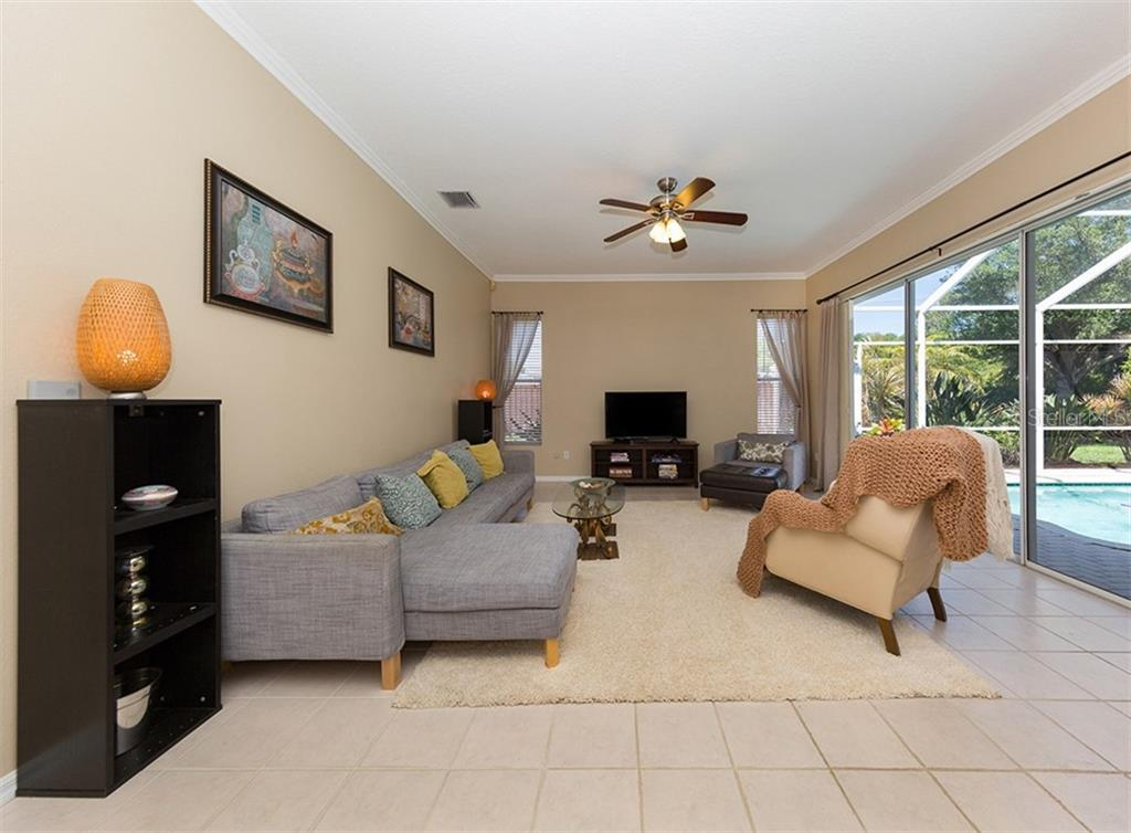 Family room - Single Family Home for sale at 129 Wayforest Dr, Venice, FL 34292 - MLS Number is N6105216