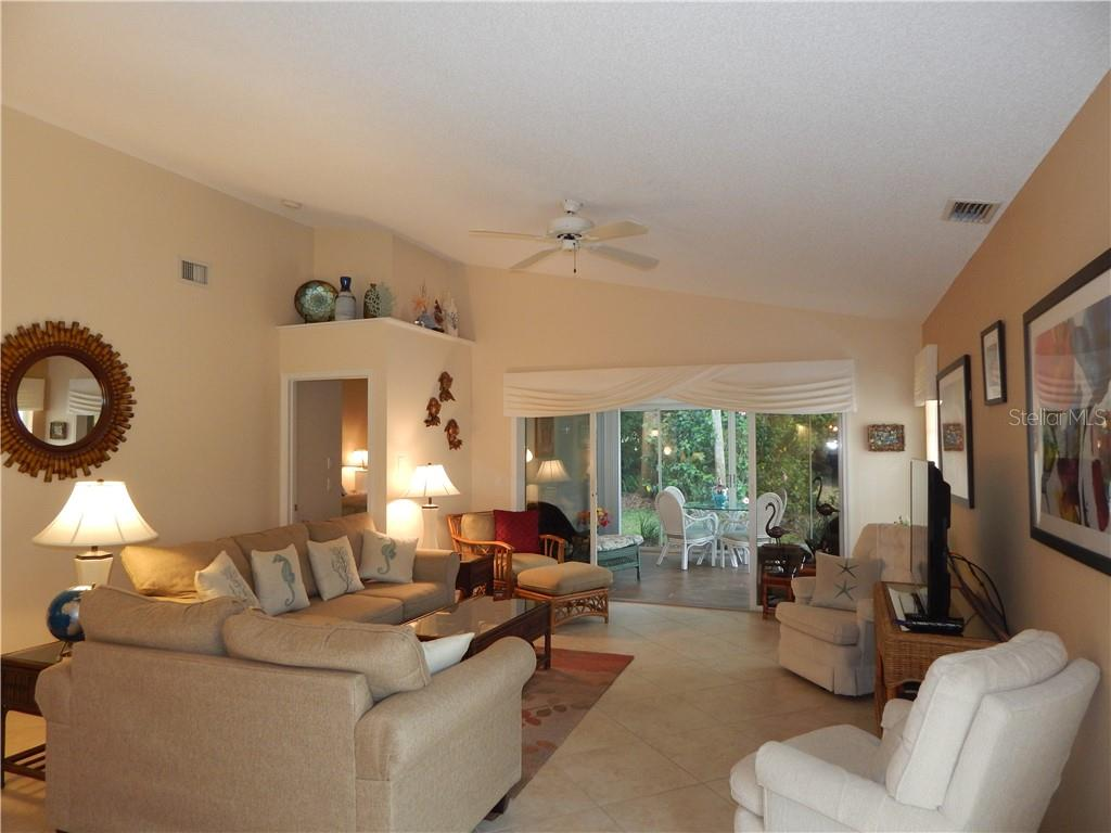 ANOTHER VIEW OF LIVING ROOM AND ENTRY TO MASTER SUITE - Villa for sale at 572 Clubside Cir #34, Venice, FL 34293 - MLS Number is N6105221