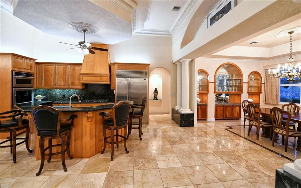 Kitchen, dining room - Single Family Home for sale at 412 Hunter Dr, Venice, FL 34285 - MLS Number is N6105563