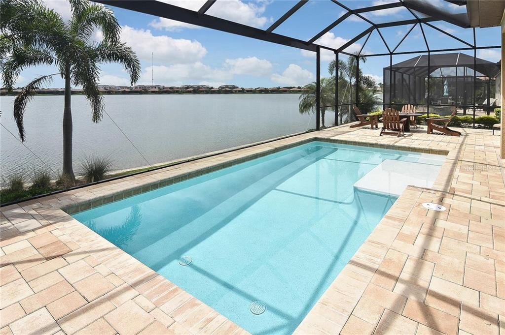 Pool, lake view - Single Family Home for sale at 166 Toscavilla Blvd, Nokomis, FL 34275 - MLS Number is N6105654