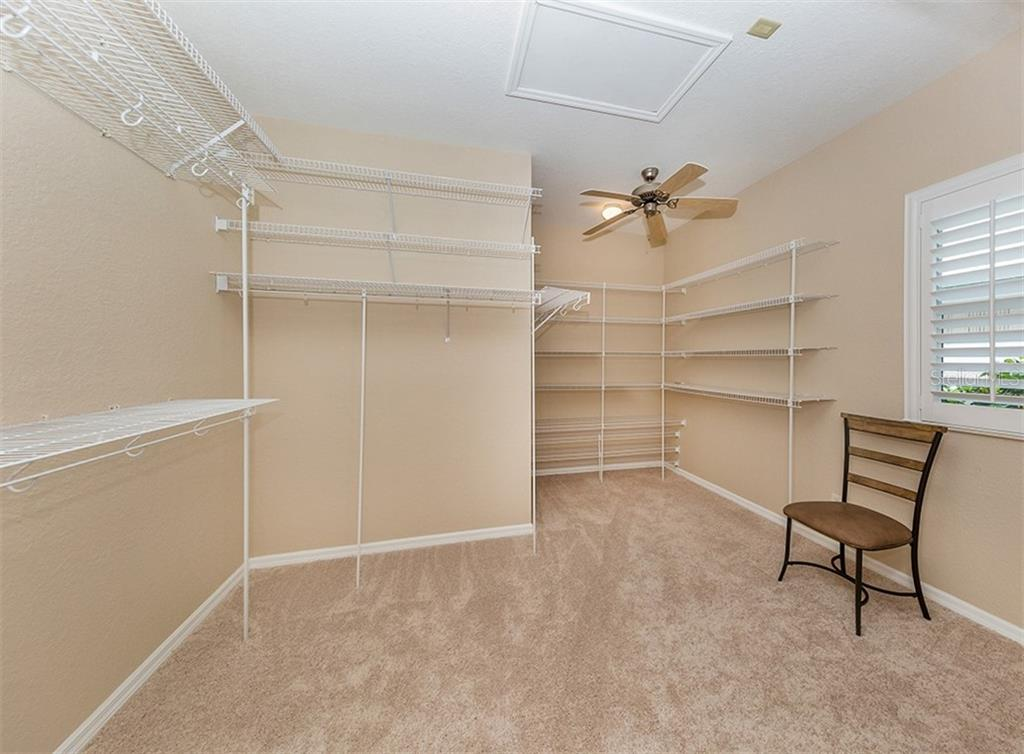 Master bedroom closet - Single Family Home for sale at 836 Connemara Cir, Venice, FL 34292 - MLS Number is N6105684