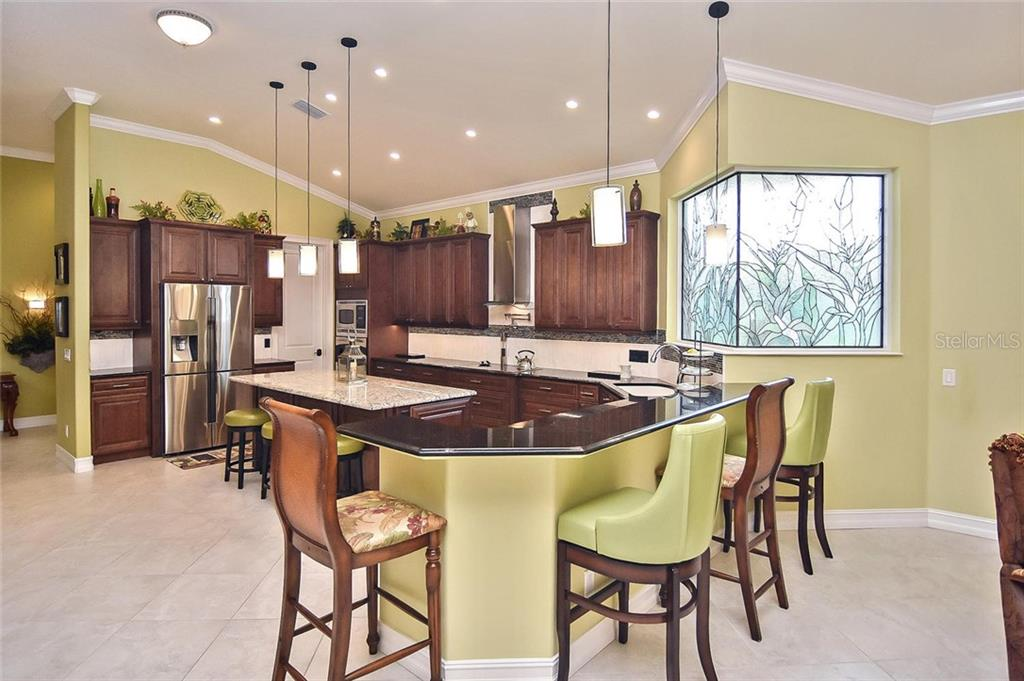Breakfast bar, kitchen - Single Family Home for sale at 753 Guild Dr, Venice, FL 34285 - MLS Number is N6105757