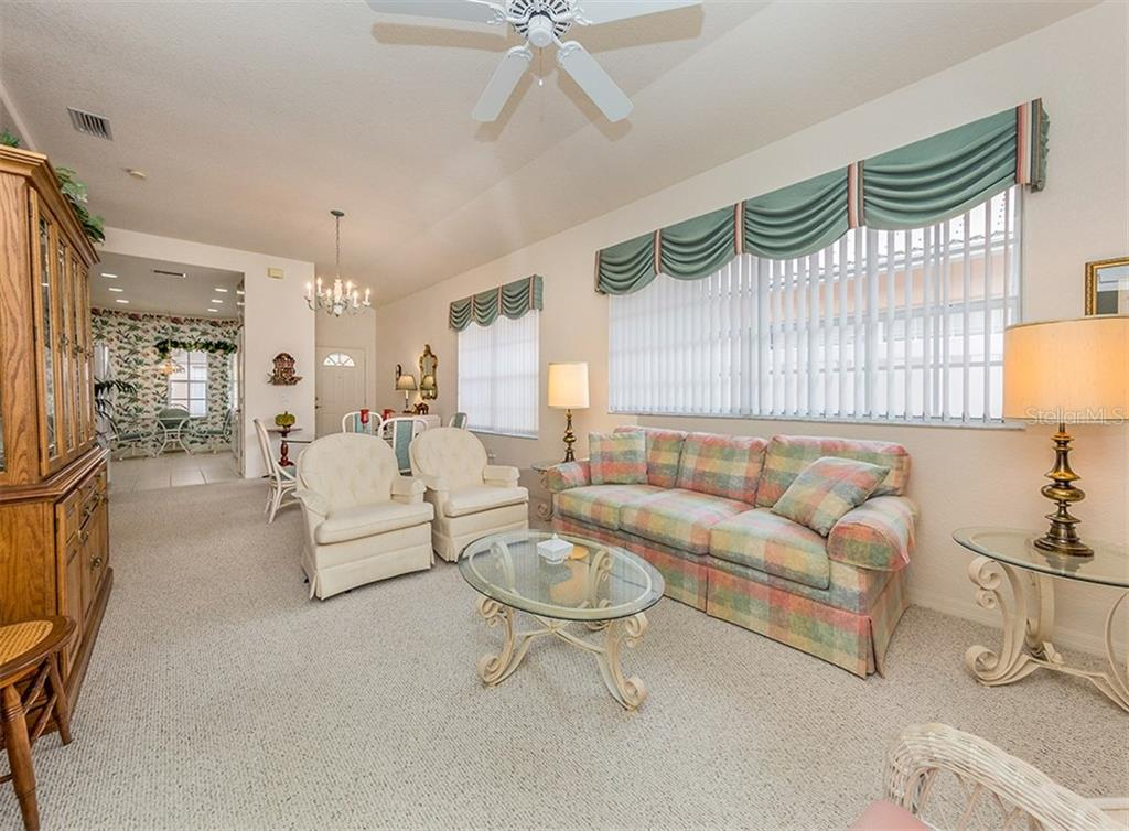 Living room to lanai - Villa for sale at 1230 Berkshire Cir, Venice, FL 34292 - MLS Number is N6105831