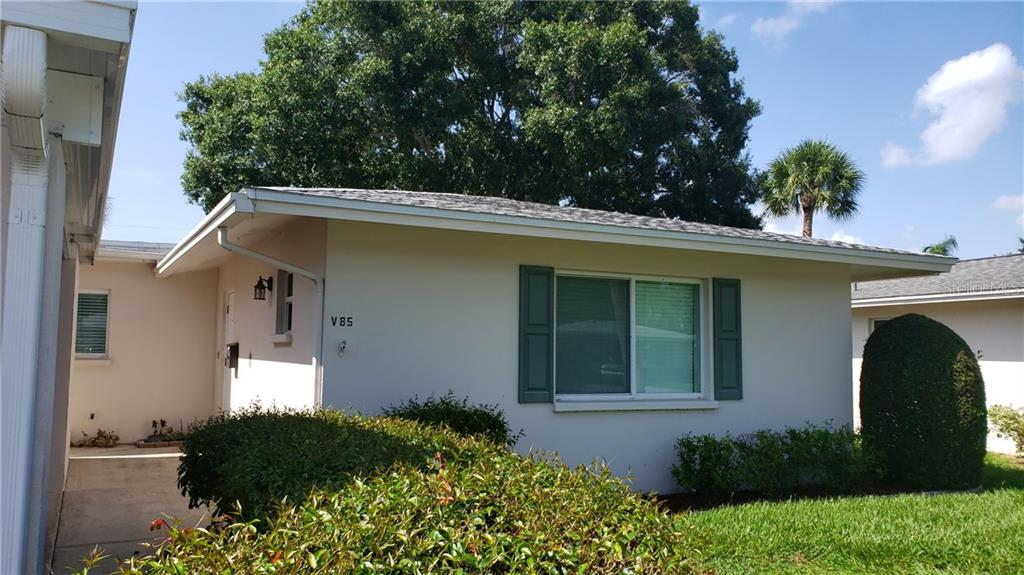 Outside of house different angle - Villa for sale at 85 Strathmore Blvd #villa8, Sarasota, FL 34233 - MLS Number is N6106092