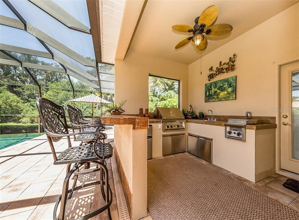 Outdoor kitchen - Single Family Home for sale at 106 Vicenza Way, North Venice, FL 34275 - MLS Number is N6106168