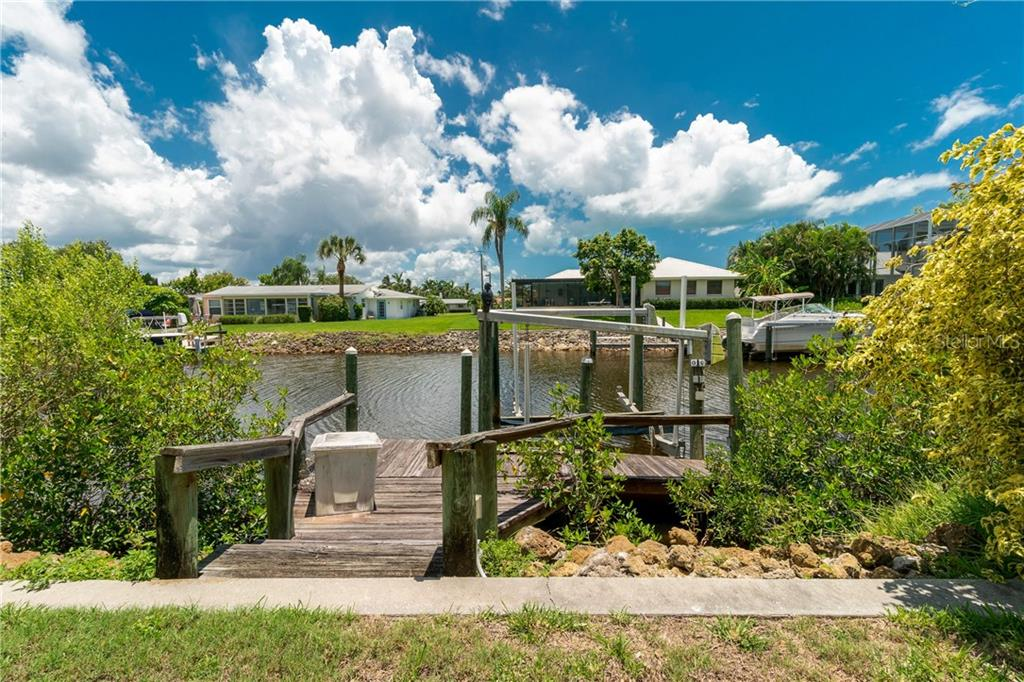 Private Boat Dock + Lift w/water and electric - Single Family Home for sale at 359 Renoir Dr, Osprey, FL 34229 - MLS Number is N6106429