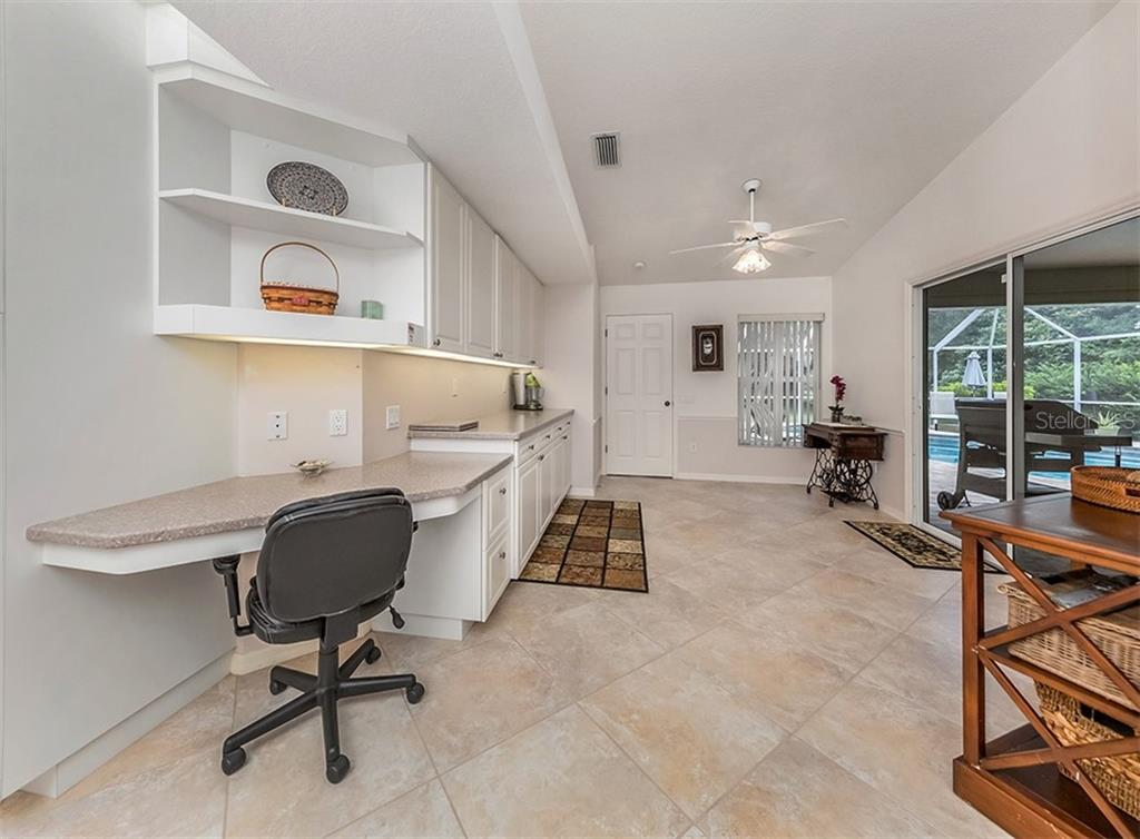 Extended kitchen - Single Family Home for sale at 521 Waterwood Ln, Venice, FL 34293 - MLS Number is N6107048