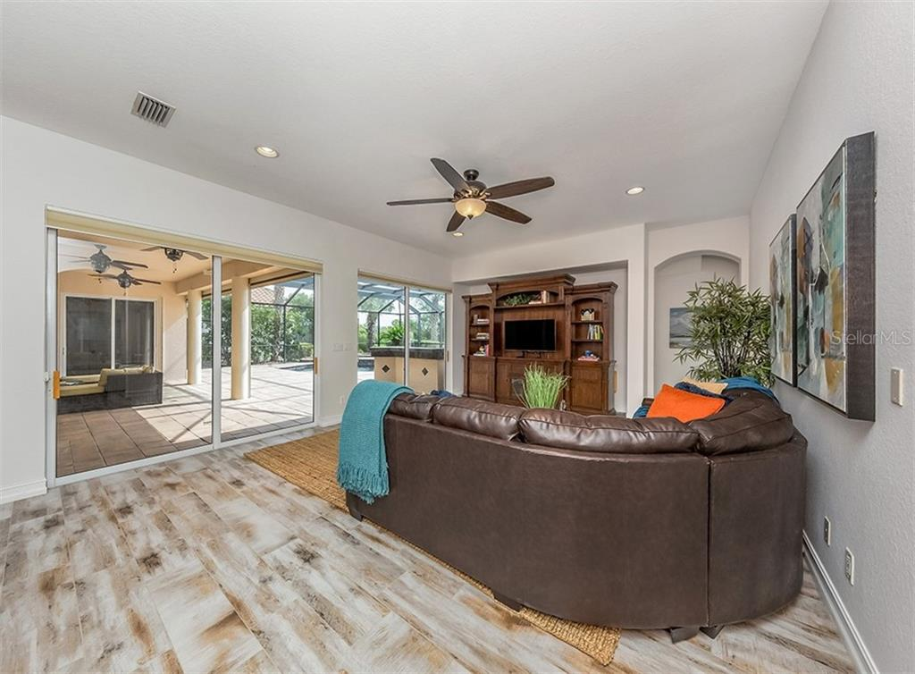 Great room with sliders to the lanai - Single Family Home for sale at 262 Pesaro Dr, North Venice, FL 34275 - MLS Number is N6107589
