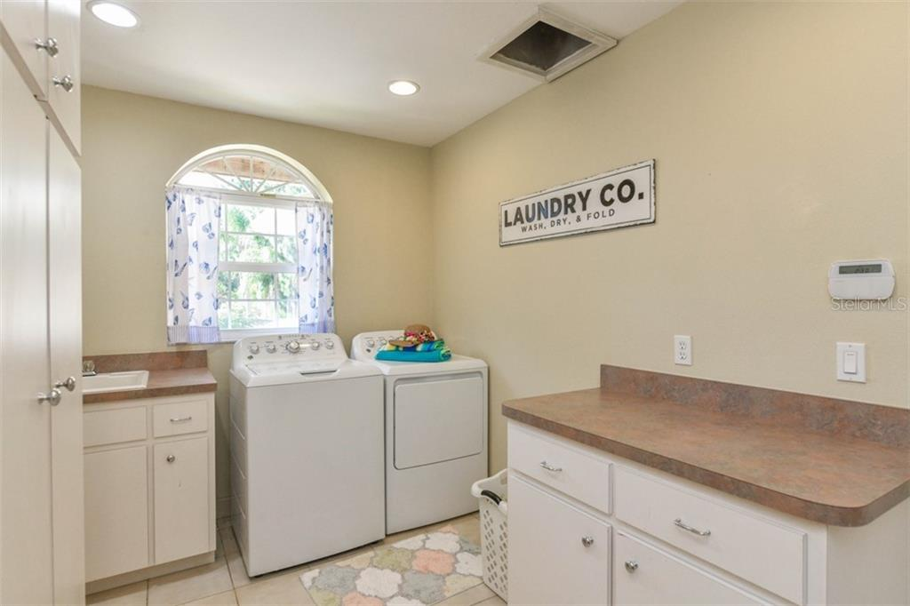 Laundry/utility room - Single Family Home for sale at 7785 Manasota Key Rd, Englewood, FL 34223 - MLS Number is N6107786