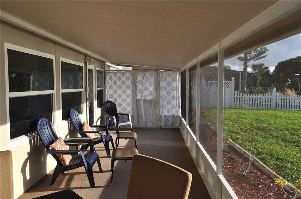 Screened in patio off the family room. - Single Family Home for sale at 1656 La Gorce Dr, Venice, FL 34293 - MLS Number is N6107911