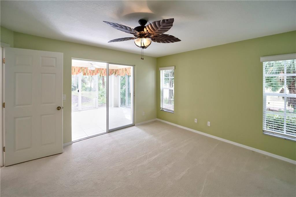 Master Bedroom with Access to Florida Room - Condo for sale at 815 Montrose Dr #101, Venice, FL 34293 - MLS Number is N6107969