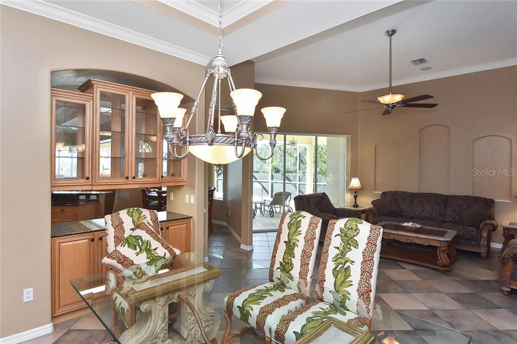 Dining room to living room - Single Family Home for sale at 321 Dulmer Dr, Nokomis, FL 34275 - MLS Number is N6108685