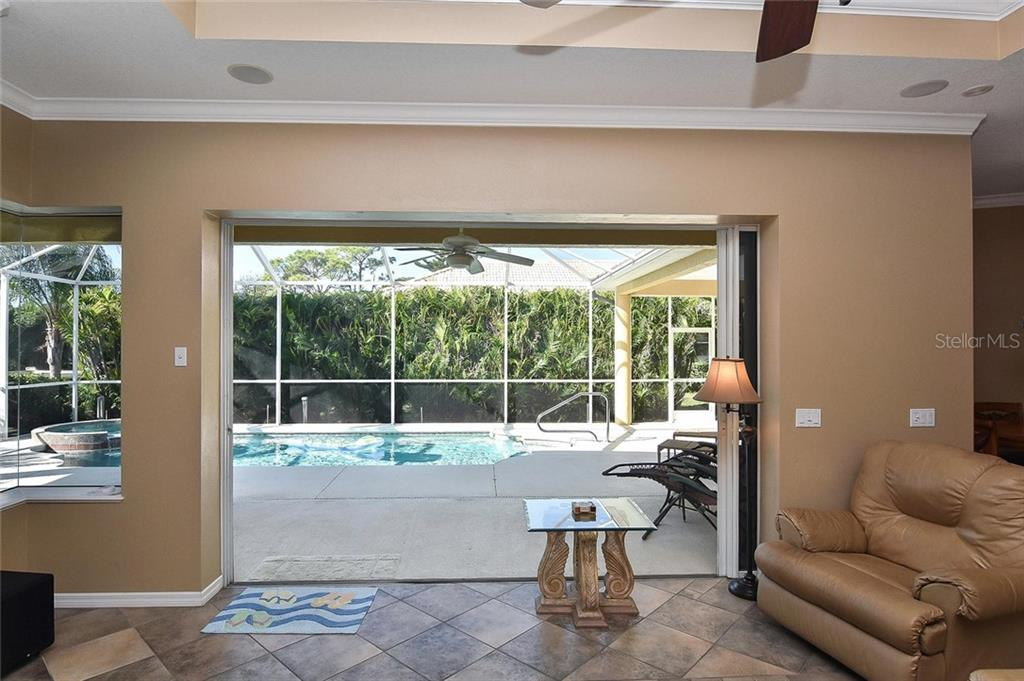 Family room with slider to lanai/pool - Single Family Home for sale at 321 Dulmer Dr, Nokomis, FL 34275 - MLS Number is N6108685