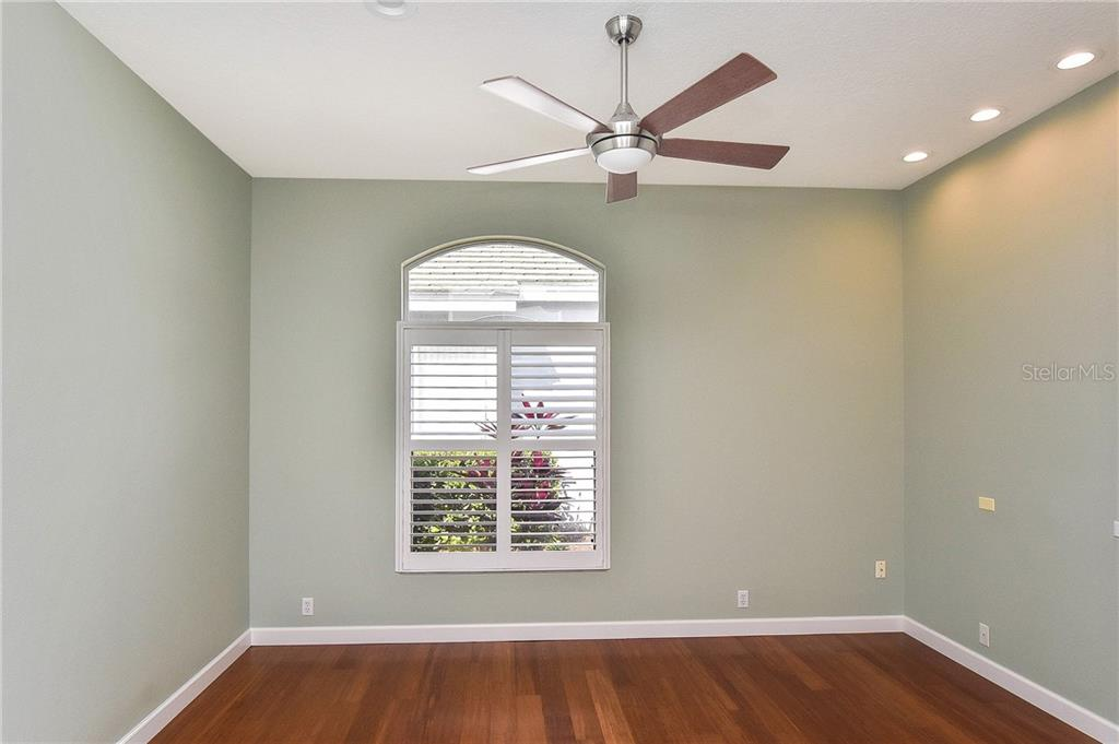 3rd bedroom/study with bamboo floors - Single Family Home for sale at 323 Lansbrook Dr, Venice, FL 34292 - MLS Number is N6109725