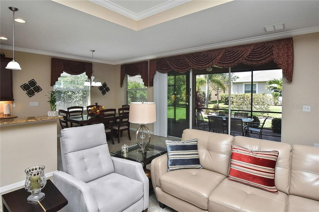 Great room with sliders to the lanai - Single Family Home for sale at 5093 Layton Dr, Venice, FL 34293 - MLS Number is N6109788