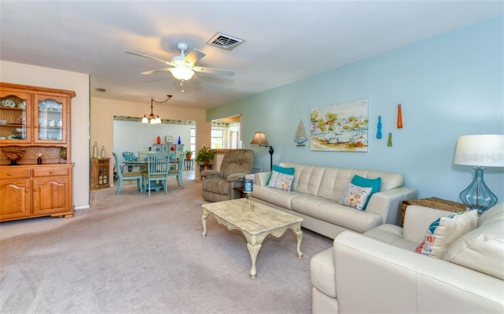 Living room, dining room - Single Family Home for sale at 404 Gulf Breeze Blvd, Venice, FL 34293 - MLS Number is N6110481