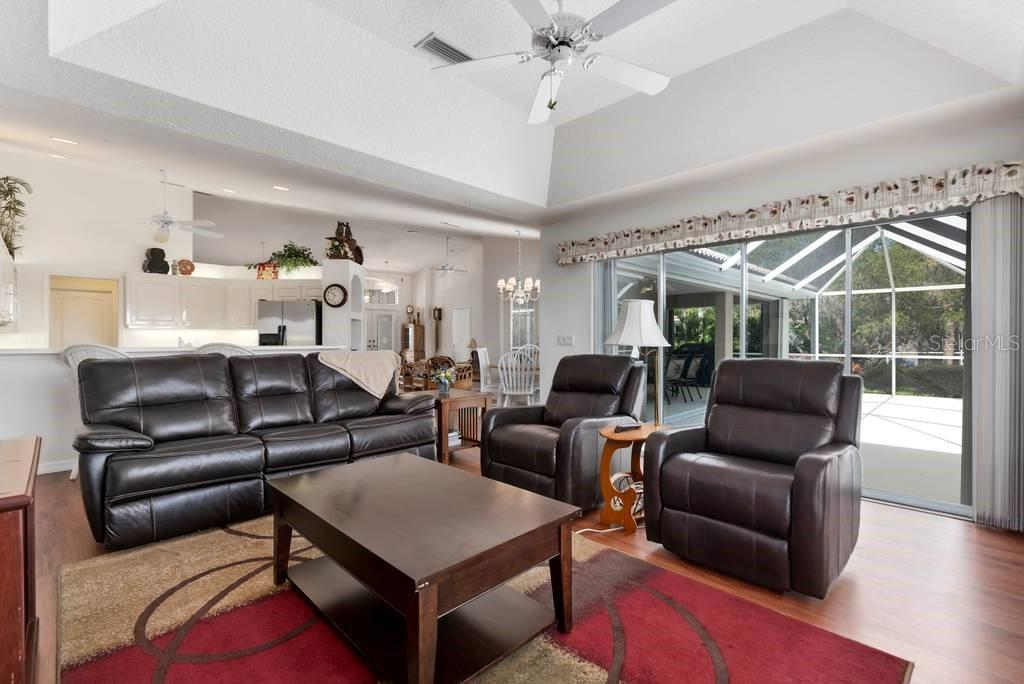 Family room with sliders to lanai - Single Family Home for sale at 498 Pine Lily Way, Venice, FL 34293 - MLS Number is N6110849