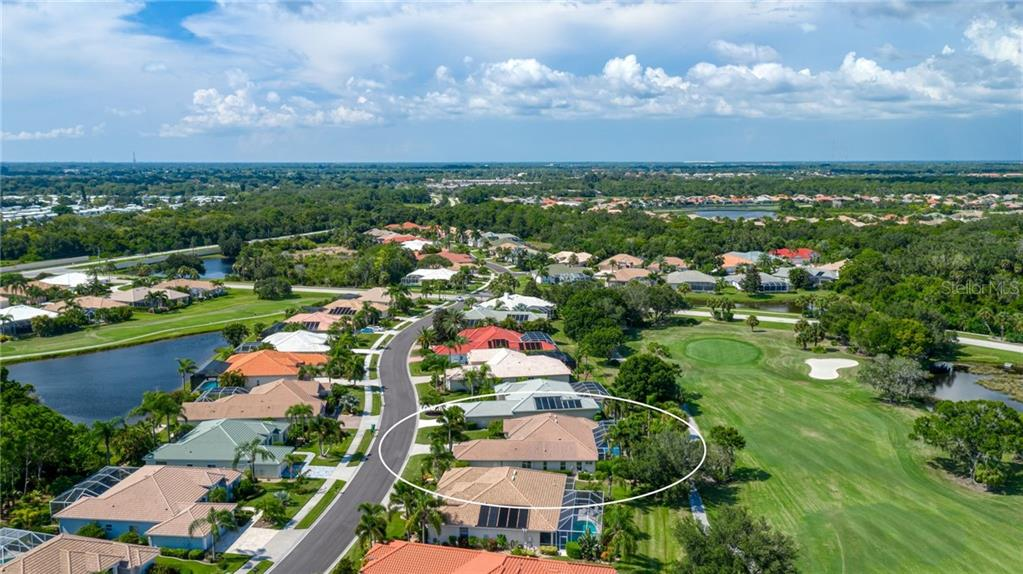 Aerial of home which is on the 4th hole of the golf course - Single Family Home for sale at 953 Chickadee Dr, Venice, FL 34285 - MLS Number is N6111180