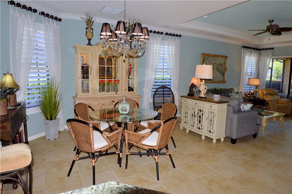 Dining room to great room - Villa for sale at 20117 Tesoro Dr, Venice, FL 34293 - MLS Number is N6111641