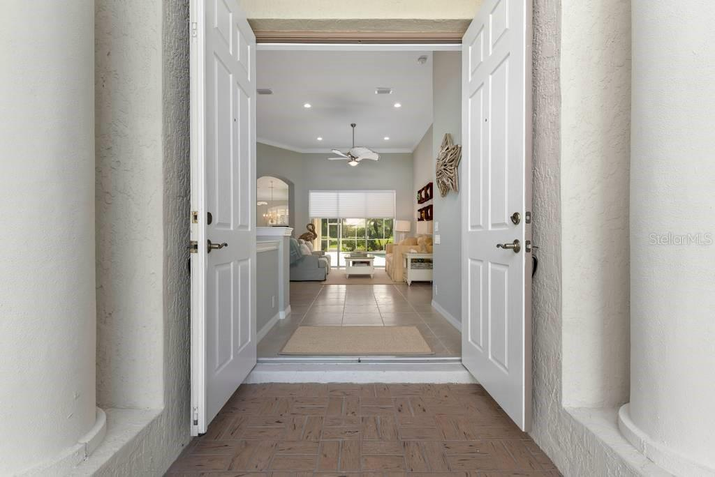 Entrance through entry doors - Single Family Home for sale at 601 Cockatoo Cir, Venice, FL 34285 - MLS Number is N6111658