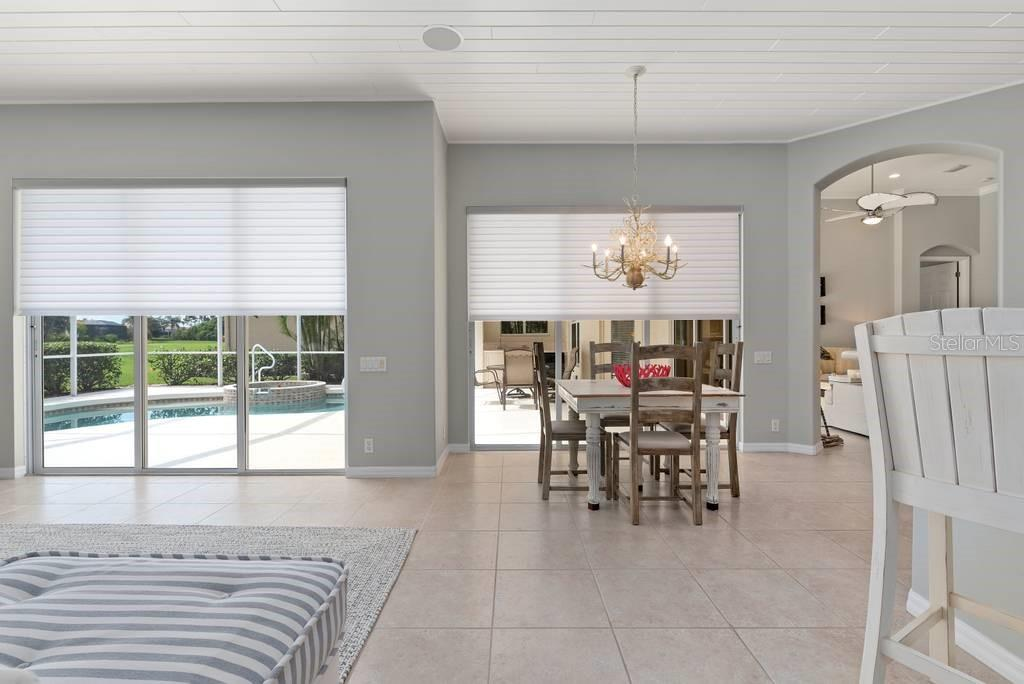 All three sliding doors have electronic Hunter Douglas luminetts. All other windows are Plantation shutters - Single Family Home for sale at 601 Cockatoo Cir, Venice, FL 34285 - MLS Number is N6111658