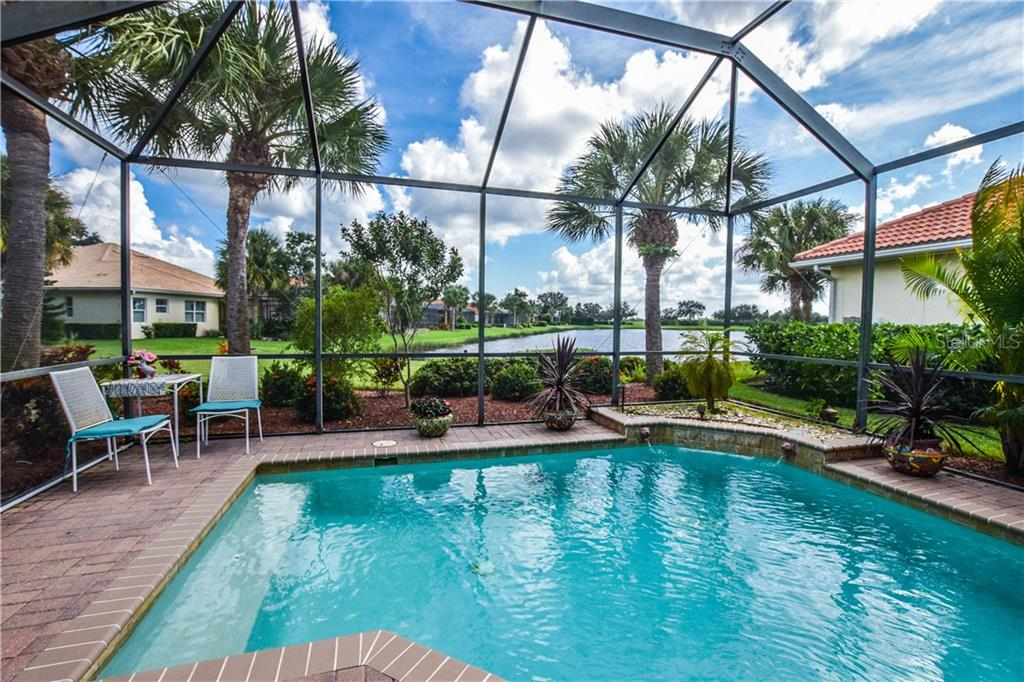 Pool with beautiful water view - Single Family Home for sale at 154 Rimini Way, North Venice, FL 34275 - MLS Number is N6112459