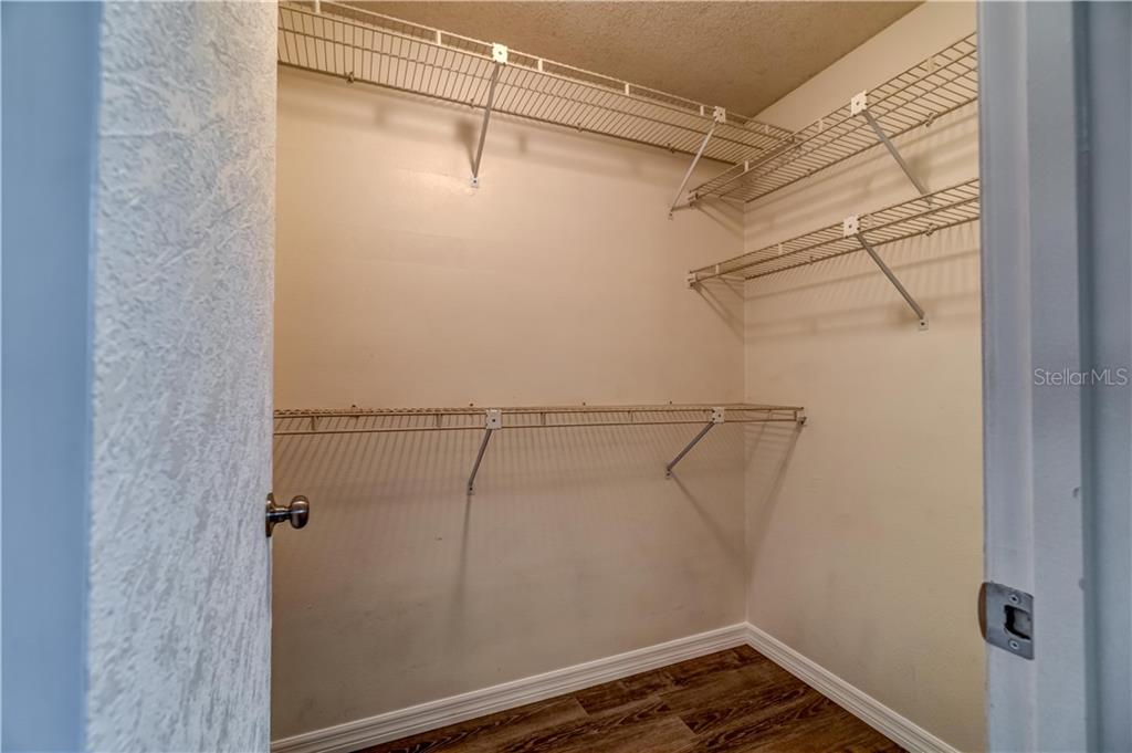 Front bedroom walk in closet - Single Family Home for sale at 607 Garden Rd, Venice, FL 34293 - MLS Number is N6113347