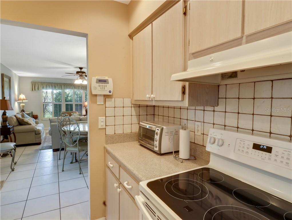 Kitchen to dining and living room - Villa for sale at 210 Brigantine Way, Nokomis, FL 34275 - MLS Number is N6114165